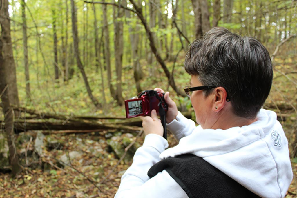 Woman taking picture on trail